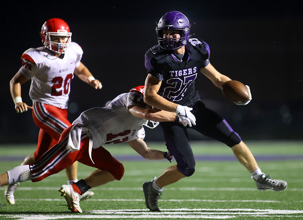9-17-21   Northwestern vs Cass football NW's Cole Cardwell looks to shake off Cass' defense as he takes the ball down the field. Kelly Lafferty Gerber | Kokomo Tribune