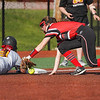 Logansport Berries third baseman Kendra Sutton (6) loses her handle on the ball as she tags McCutcheon Mavericks' Kennedy Peckinpaugh (21) during the fourth inning of a game between the Logansport Berries and McCutcheon Mavericks on Tuesday, April 27, 2021 in Logansport.