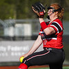 Logansport Berries pitcher Claire Kitchel (12) throws a pitch during the fourth inning of a game between the Logansport Berries and McCutcheon Mavericks on Tuesday, April 27, 2021 in Logansport.