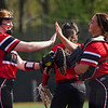Logansport Berries pitcher Claire Kitchel (12) high fives teammates before a game between the Logansport Berries and McCutcheon Mavericks on Tuesday, April 27, 2021 in Logansport.