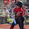 Logansport Berries infielder Pailei Cripe (19) hits a double during the first inning of a game between the Logansport Berries and McCutcheon Mavericks on Tuesday, April 27, 2021 in Logansport.