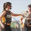 Pioneer Panthers infielder Hailey Cripe (12) bumps gloves with pitcher Hailey Gotshall (15) after the second inning of the semistate championship game between the Fairfield Falcons and Pioneer Panthers on Saturday, June 5, 2021 in Chalmers.