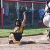 Pioneer Panthers infielder Kylie Farris (2) slides into home during the second inning of the semistate championship game between the Fairfield Falcons and Pioneer Panthers on Saturday, June 5, 2021 in Chalmers.