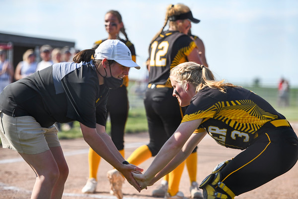 Coach Gabby Thomas high fives catcher Mackenzie Walker (3) during player introductions before the semistate championship game between the Fairfield Falcons and Pioneer Panthers on Saturday, June 5, 2021 in Chalmers.