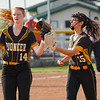 Pioneer Panthers infielder Madison Blickenstaff (14) and pitcher Hailey Gotshall (15) walk off the field during the first inning of the regional championship between the Wheeler Bearcats and Pioneer Panthers on Tuesday, June 1, 2021 in Valparaiso.
