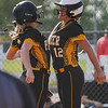 Pioneer Panthers infielder Hailey Cripe (12) chest bumps catcher Mackenzie Walker (3) after hitting a solo home run during the first inning of the regional championship between the Wheeler Bearcats and Pioneer Panthers on Tuesday, June 1, 2021 in Valparaiso.