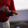 An IHSAA official loads the starting pistol during the boys track and field sectional at Kokomo High School on Thursday, May 20, 2021 in Kokomo.