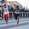 Pioneer's Ezra Lewellen crosses the finish line in the 100 meter dash followed by his brother Addai and Kokomo's Plez Lawrence during the boys track and field sectional at Kokomo High School on Thursday, May 20, 2021 in Kokomo.