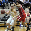 Monarch's Ashton Davis (left) runs past Fairview's Sonia Ghosh (right) during their basketball game at Monarch High School in Louisville, Colorado February 10, 2012. CAMERA/MARK LEFFINGWELL