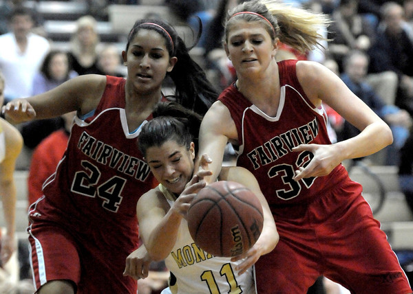 Monarch's Rebecca Richmond (middle) collides with Fairview's Sonia Ghosh (left) and Georgiana Ryder (right) going for a loose ball during their basketball game at Monarch High School in Louisville, Colorado February 10, 2012. CAMERA/MARK LEFFINGWELL