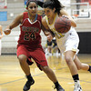 Fairview's Sonia Ghosh (left) guards Monarch's Rebecca Richmond (right) during their basketball game at Monarch High School in Louisville, Colorado February 10, 2012. CAMERA/MARK LEFFINGWELL