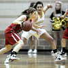 Monarch's Rebecca Richmond (left) pressures Fairview's Julia D'Amico (left) during their basketball game at Monarch High School in Louisville, Colorado February 10, 2012. CAMERA/MARK LEFFINGWELL