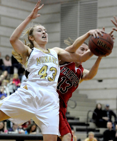 Monarch's Mae Williams (left) and Fairview's Katie Kuosman (right) go for a rebound during their basketball game at Monarch High School in Louisville, Colorado February 10, 2012. CAMERA/MARK LEFFINGWELL