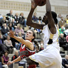 Monarch's Alexus Johnson (right) is fouled by Fairview's Katie Kuosman (left) during their basketball game at Monarch High School in Louisville, Colorado February 10, 2012. CAMERA/MARK LEFFINGWELL