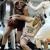 Monarch's Ashton Davis (right) and Fairview's Georgina Ryder (left) wrestle for the ball during their basketball game at Monarch High School in Louisville, Colorado February 10, 2012. CAMERA/MARK LEFFINGWELL