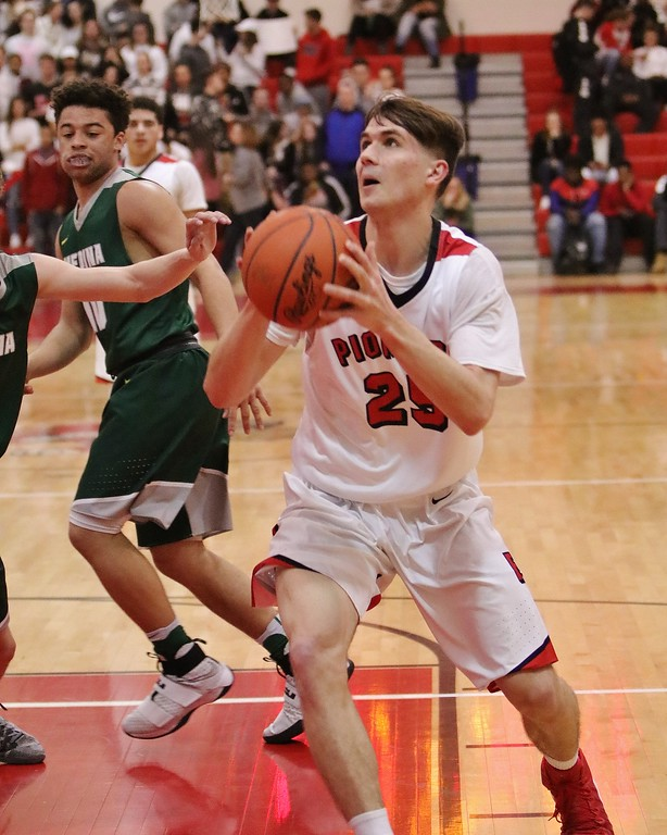 . Elyria\'s Josh Lotko takes a quick shot under the basket. Amanda K. Rundle -- The Morning Journal