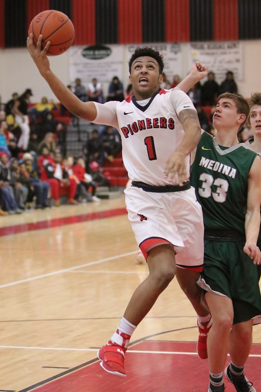 . Elyria\'s Dontae Beckett makes a shot after the contact from a Medina defender. Amanda K. Rundle -- The Morning Journal