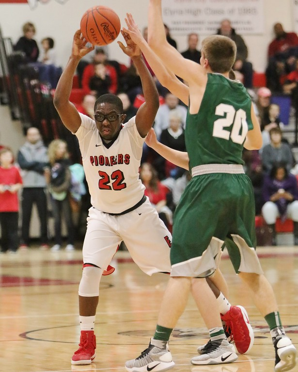 . Elyria\'s Deviian Williams makes a tw- handed pass with a double team from the Medina defense. Amanda K. Rundle -- The Morning Journal