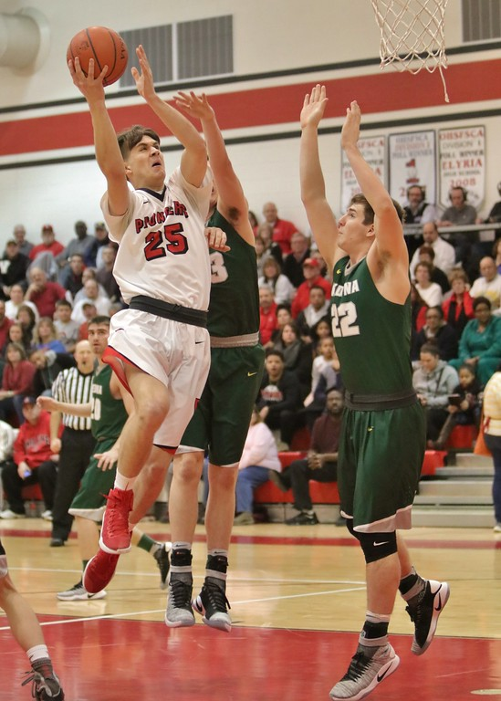 . Elyria\'s Josh Lotko floats in for a layup over the Medina defense. Amanda K. Rundle -- The Morning Journal