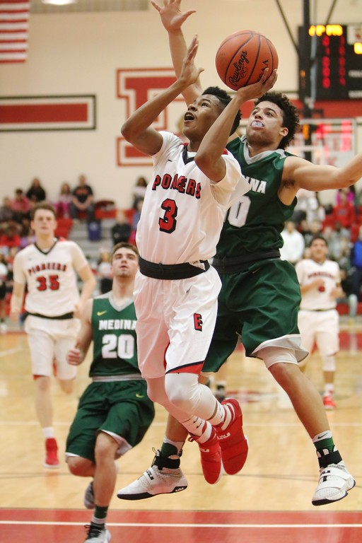 . Elyria\'s Michael Oliver grabs a pass and takes the ball to the basket against Medina. Amanda K. Rundle -- The Morning Journal