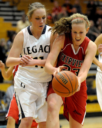 Fairview's Hannah Hyde (right) and Legacy's Emily Glen (left) collide going for the ball during their basketball game at Legacy High School in Broomfield, Colorado February 13, 2012. CAMERA/MARK LEFFINGWELL