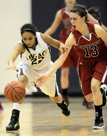 Fairview's Katie Kuosman (right) and Legacy's Kailey Edwards (left) race for a loose ball during their basketball game at Legacy High School in Broomfield, Colorado February 13, 2012. CAMERA/MARK LEFFINGWELL
