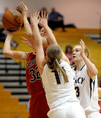 Fairview's Georgiana Ryder (left) is blocked by Legacy's Emily Glen (center) and Courtney Smith (right) during their basketball game at Legacy High School in Broomfield, Colorado February 13, 2012. CAMERA/MARK LEFFINGWELL