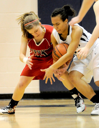 Fairview's Julia D'Amico (left) and Legacy's Mackenzie Neely (right) go for a loose ball during their basketball game at Legacy High School in Broomfield, Colorado February 13, 2012. CAMERA/MARK LEFFINGWELL