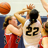 Fairview's Hannah Hyde (left) fouls Legacy's Kailey Edwards (right) during their basketball game at Legacy High School in Broomfield, Colorado February 13, 2012. CAMERA/MARK LEFFINGWELL