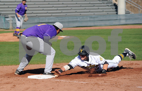 photo by Sarah A. Miller/Tyler Morning Telegraph  Tyler Junior College's (34) Austin Drolette is safe before Texas College's (41) Juan Carrillo can tag him out at first base Wednesday at Mike Carter Field in Tyler.