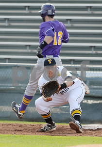 photo by Sarah A. Miller/Tyler Morning Telegraph  Texas College's (12) Juan Mesa is safe as he clears first base before Tyler Junior College's (22) Blaise Warrick catches the ball Wednesday at Mike Carter Field in Tyler.