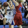 Broomfield's Morgan Rynearson (left) takes a shot while being guarded by Centaurus' Taylor Langer (right) during their basketball game at Broomfield High School in Broomfield, Colorado February 14, 2012. CAMERA/MARK LEFFINGWELL