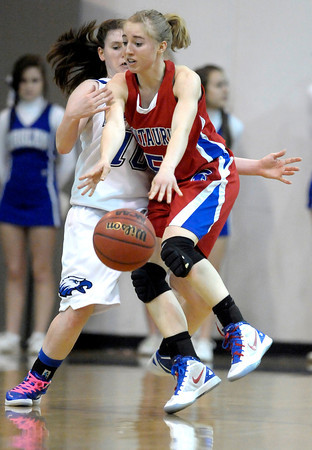 Centaurus' Jordan Matosky (right) collides with Broomfield's Brianna Wilber (left) during their basketball game at Broomfield High School in Broomfield, Colorado February 14, 2012. CAMERA/MARK LEFFINGWELL