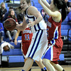 Broomfield's Stacie Hull (left) tries to get around Centaurus' Midori Patterson (right) during their basketball game at Broomfield High School in Broomfield, Colorado February 14, 2012. CAMERA/MARK LEFFINGWELL