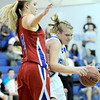Broomfield's Callie Kaiser (right) tries to get past Centaurus' Taylor Langer (left) during their basketball game at Broomfield High School in Broomfield, Colorado February 14, 2012. CAMERA/MARK LEFFINGWELL