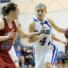 Broomfield's Morgan Rynearson (right) is guarded by Centaurus' Andi Houck (left) during their basketball game at Broomfield High School in Broomfield, Colorado February 14, 2012. CAMERA/MARK LEFFINGWELL