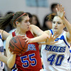 Centaurus' Andi Houck (left) is pressured by Broomfield's Taylor Schreter (right) during their basketball game at Broomfield High School in Broomfield, Colorado February 14, 2012. CAMERA/MARK LEFFINGWELL