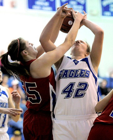 Centaurus' Andi Houck (left) and Broomfield's Stacie Hull go for a rebound during their basketball game at Broomfield High School in Broomfield, Colorado February 14, 2012. CAMERA/MARK LEFFINGWELL