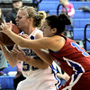 Centaurus' Maurissa Ortega (right) knocks the ball out of the hands of Broomfield's Callie Kaiser (left) during their basketball game at Broomfield High School in Broomfield, Colorado February 14, 2012. CAMERA/MARK LEFFINGWELL