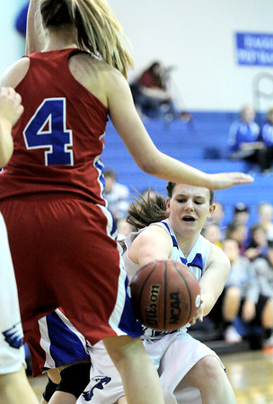 Broomfield's Taylor Schreter (right) tries to pass around Centaurus' Taylor Langer (left)  during their basketball game at Broomfield High School in Broomfield, Colorado February 14, 2012. CAMERA/MARK LEFFINGWELL