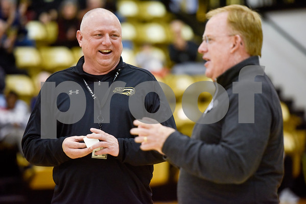 Tyler Junior College soccer head coach Steve Clements, left, receives a National Championship ring during a college basketball game at Tyler Junior College in Tyler, Texas, on Wednesday, Feb. 14, 2018. (Chelsea Purgahn/Tyler Morning Telegraph)