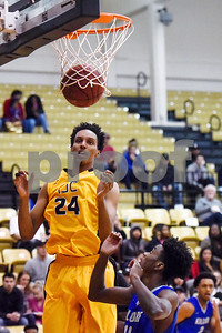 Tyler Junior College freshman Edra Luster (24) jumps to grab the ball after Kilgore Community College freshman Malachi Davidson, not pictured, made a basket during a college basketball game at Tyler Junior College in Tyler, Texas, on Wednesday, Feb. 14, 2018. The TJC Apaches beat the Kilgore Rangers 72-62. (Chelsea Purgahn/Tyler Morning Telegraph)