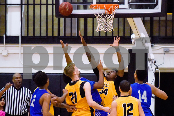 Tyler Junior College and Kilgore Community College players reach for the ball during a college basketball game at Tyler Junior College in Tyler, Texas, on Wednesday, Feb. 14, 2018. (Chelsea Purgahn/Tyler Morning Telegraph)