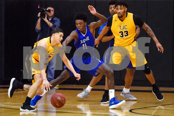 Tyler Junior College sophomore Desmond Balentine (12) tries to dribble the ball past Kilgore Community College freshman James Conteh (11) during a college basketball game at Tyler Junior College in Tyler, Texas, on Wednesday, Feb. 14, 2018. The TJC Apaches beat the Kilgore Rangers 72-62. (Chelsea Purgahn/Tyler Morning Telegraph)