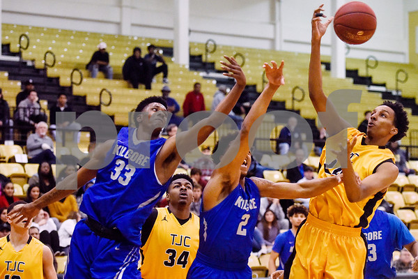 Kilgore Community College and Tyler Junior College players reach for the ball during a college basketball game at Tyler Junior College in Tyler, Texas, on Wednesday, Feb. 14, 2018. The TJC Apaches beat the Kilgore Rangers 72-62. (Chelsea Purgahn/Tyler Morning Telegraph)