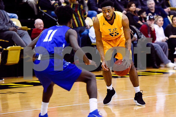 Tyler Junior College sophomore TiAndre Jackson-Young (22) dribbles the ball as Kilgore Community College freshman James Conteh (11) guards him during a college basketball game at Tyler Junior College in Tyler, Texas, on Wednesday, Feb. 14, 2018. (Chelsea Purgahn/Tyler Morning Telegraph)