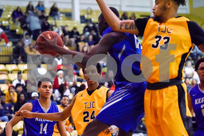 Kilgore Community College sophomore Samory Gueye (14) and Tyler Junior College freshman Edra Luster (24) watch game action during a college basketball game at Tyler Junior College in Tyler, Texas, on Wednesday, Feb. 14, 2018. The TJC Apaches beat the Kilgore Rangers 72-62. (Chelsea Purgahn/Tyler Morning Telegraph)