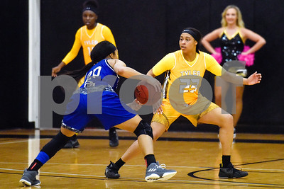 Kilgore Community College sophomore Danielle Meador (20) dribbles the ball as Tyler Junior College freshman Keyneso Hunter (23) guards her during a college basketball game at Tyler Junior College in Tyler, Texas, on Wednesday, Feb. 14, 2018. The Kilgore Lady Rangers beat the Tyler Lady Apaches 78-72. (Chelsea Purgahn/Tyler Morning Telegraph)