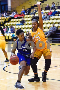 Kilgore Community College freshman Patience Idoko (31) dribbles the ball as Tyler Junior College freshman Londan Mallet (3) guards her during a college basketball game at Tyler Junior College in Tyler, Texas, on Wednesday, Feb. 14, 2018. The Kilgore Lady Rangers beat the Tyler Lady Apaches 78-72. (Chelsea Purgahn/Tyler Morning Telegraph)