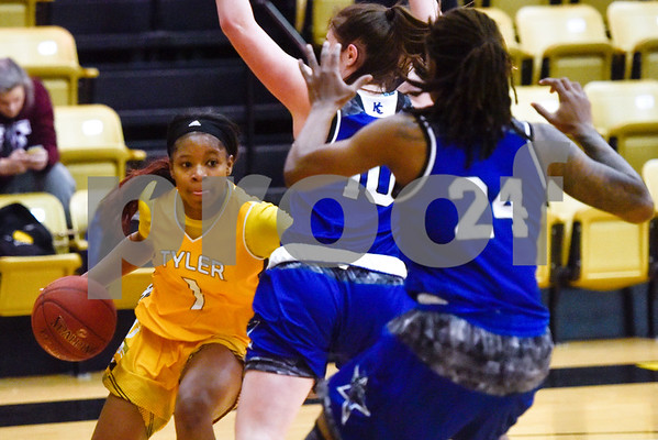 Tyler Junior College sophomore Djhai Patterson-Ricks (1) dribbles the ball as Kilgore Community College freshman Alex Strawhorn (10) and sophomore Alicia Mardis (24) guard her during a college basketball game at Tyler Junior College in Tyler, Texas, on Wednesday, Feb. 14, 2018. The Kilgore Lady Rangers beat the Tyler Lady Apaches 78-72. (Chelsea Purgahn/Tyler Morning Telegraph)